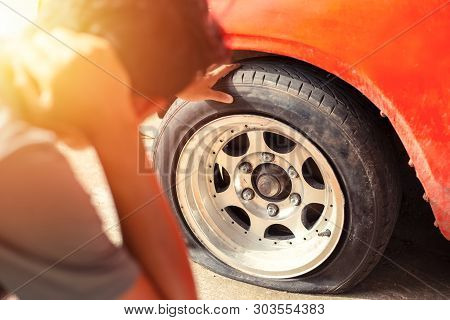 Car Breakdown And Wheel Flat Tire On The Road In The City.