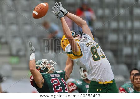 INNSBRUCK, AUSTRIA - JULY 10: CB Josue Romero (#21 MEX) and WR Luke Fredericks (#83 AUS) fight for the ball at the Football World Championship on July 10, 2011 in Innsbruck, Austria.