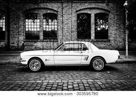 Berlin - May 11, 2019: Pony Car Ford Mustang (first Generation). Black And White. 32th Berlin-brande