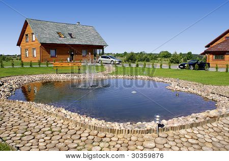 Red Wooden House At The Pond