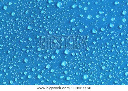 Water Drops On A Blue Surface