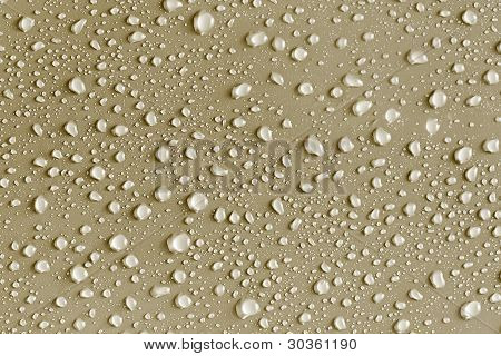 Water Drops On A Gold Surface