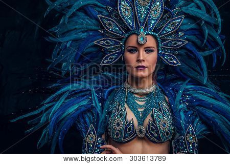 Happy Brasil Dancer Is Posing For Photographer. She Is Wearing Blue Feather Costume.