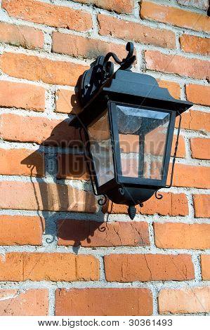 Wrought Lantern On A Brick Wall