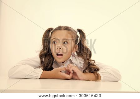 Pupil lean desk isolated white. Perfect schoolgirl tidy fancy hair. School as stranger environment. Prepare kid first school day. Schoolgirl stressful scared worrying face. Stressful event for her. poster
