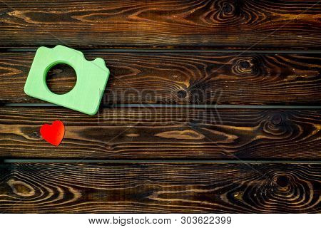 Photo Camera Concept With Heart On Wooden Background Top View Mock Up