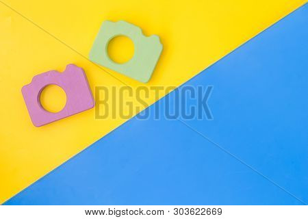 Photo Camera Concept On Yellow And Blue Background Top View Copy Space