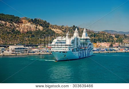 Barcelona, Spain - March 30, 2016: Ocean Liner Gnv Rhapsody Genova In Sea Harbor At Mountains. Cruis