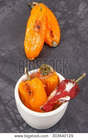 Moldy And Wrinkled Peppers. Concept Of Unhealthy, Decompose, Spoiled Vegetable