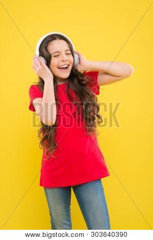 Catch The Rhythm. Child Or Teen Enjoy Music Playing In Earphones. Little Girl Enjoying Her Favorite