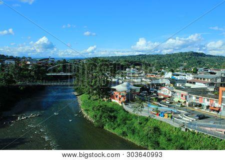 Tena, Ecuador, 18-4-2019: View Of Two Bridges And The River Napo That Slices Through Tena, Ecuador