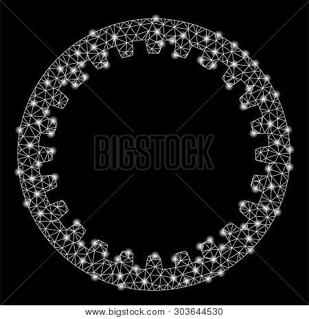 Bright Mesh Annular Gear With Glare Effect. Shiny Wire Frame Polygonal Mesh In Vector Format On A Bl