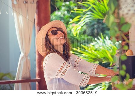Beautiful Woman Laughing At Bar In Vacation. Healthy People Lifestyle. Woman Relaxing In Cocktail Ba