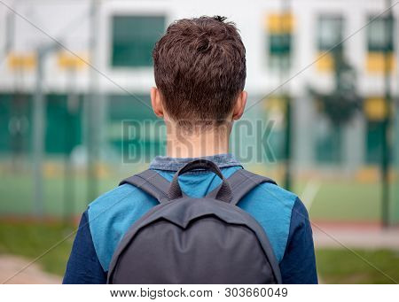Back View - Schoolchild Go To School With Backpack. Cute Child - Teen Boy With Bag Against The Backg