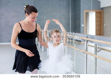 Little Ballerina And Ballet Teacher Have Practice In Classical Dancing School. Dance Trainer Is Teac