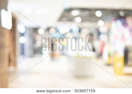Abstract Blur Shopping Mall Corridor. Blurred Retail And Hall Interior In Department Store. Defocuse
