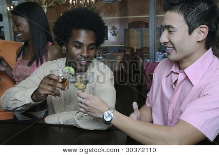 Young men toasting each other