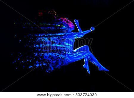 Ultraviolet black light glowing bodyart on young womans body. Dispersing girl on black background. Art creative concept poster
