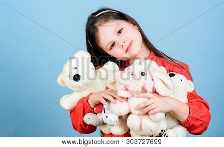 Happy childhood. Little girl play with soft toy teddy bear. Sweet childhood. Collecting toys hobby. Cherishing memories of childhood. Childhood concept. Small girl smiling face with favorite toys poster