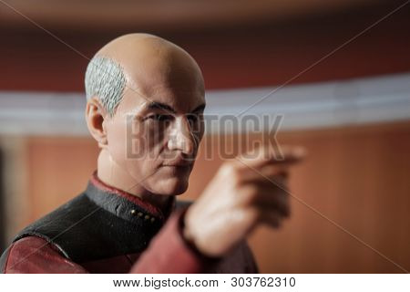 MAY 27 2019: Recreation of a scene from Star Trek Next Generation with a likeness of Sir Patrick Stewart as Captain Jean-Luc Picard in his ready room - Make it so - McFarlane action figure