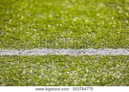 White Sideline Of Soccer Football Field. Closeup Of White Sideline. Football Pitch Background