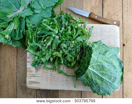 Kale Cabbage. Tuscan Or Black Kale On Wooden Table. Winter Cabbage Known As Italian Kale Or Lacinato
