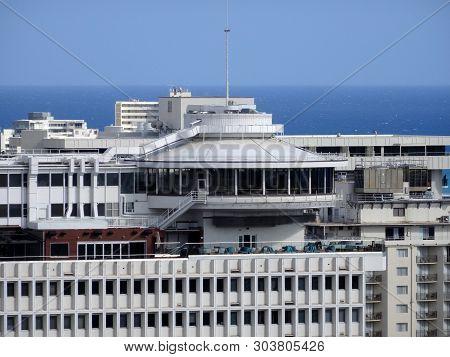 Waikiki - May 8, 2016: Waikiki Business Plaza Featuring Sky Waikiki Open-air Lounge Atop A 19-story
