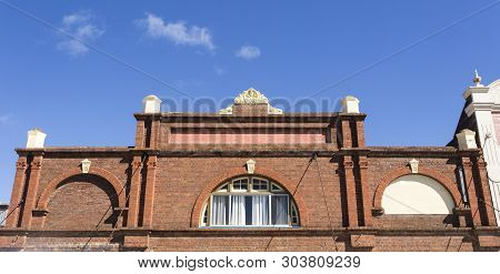 Glen Innes, Australia - April 12, 2019: Brick Facade Of A Neo-classical Residential Building, With P