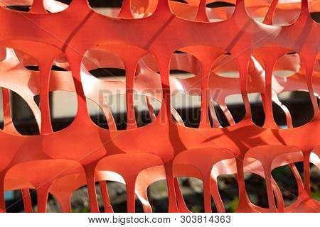 Orange Plastic Construction Barrier Fence Abstract Ribbon