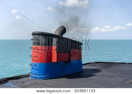 Smoke From Ferry Boat Flue During Sea With Sunlight, Sea Water And Clear Sky In Background, Thailand
