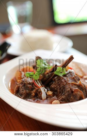 Beef Massaman Curry With Rice And Salad On Wooden Background , Thai Food