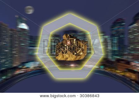 Nugget Of Precious Yellow Metal Against A Panorama Of A City
