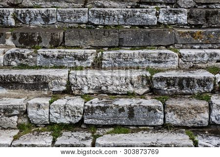 Old damaged stone staircase, up and down, textured background
