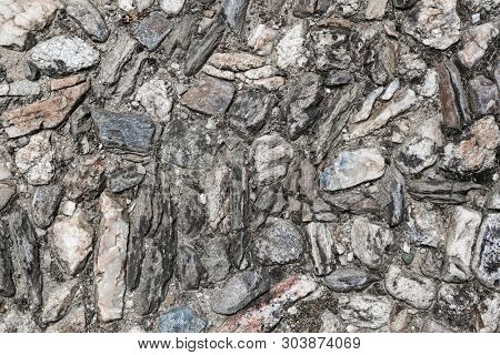 Background of ancient road paved with cobblestone