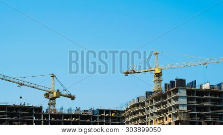 Time-lapse Construction Cranes And Workers Building Multi-storey Building Zoom Out