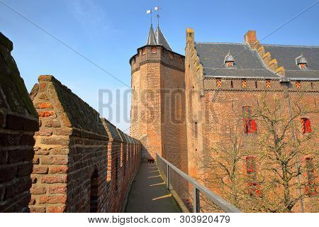 Muiden, Netherlands - April 7, 2019: Muiderslot Castle, A Medieval Castle, With The Battlements In T