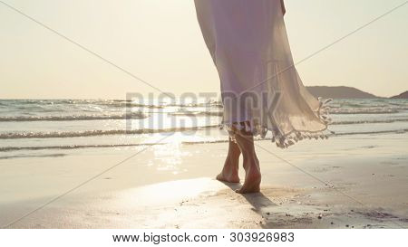 Young Asian Woman Walking On Beach. Beautiful Female Happy Relax Walking On Beach Near Sea When Suns
