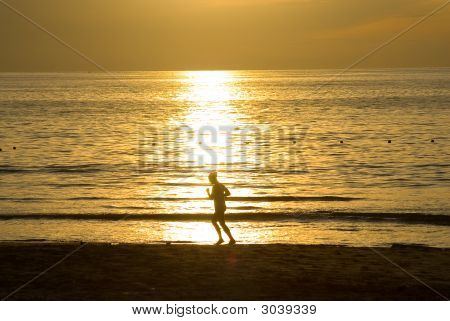 Runing Woman At The Sunrise