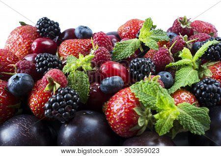 Ripe Strawberries, Blackberries, Blueberries, Raspberries, Red Berries Abd Plum. Mix Berries And Fru