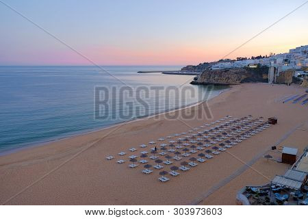View On The Beach Praia Do Tunel And Albufeira In Algarve, Portugal On The Sunset.