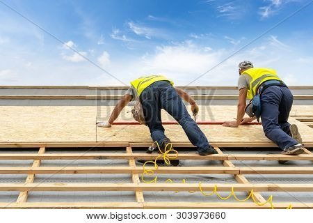 Concept Of Building New Wood Or Wooden House. Two Mature And Professional Worker Standing On Roof To