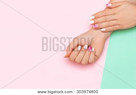 Perfect Manicure With Trendy Nail Art On Pink And Turqoise Background With Copy Space