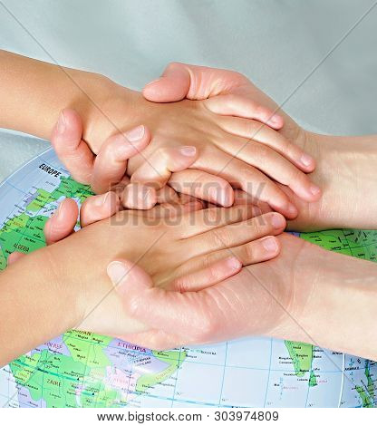 Hand With Globe Of The World Stock Photo