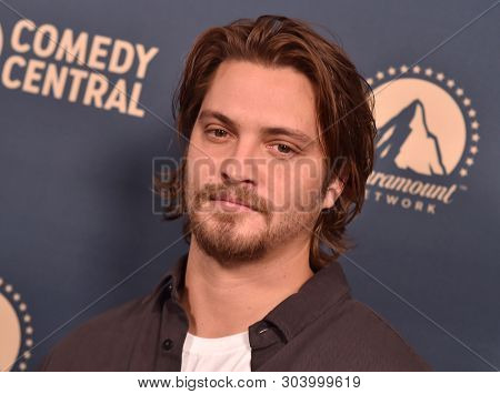 LOS ANGELES - MAY 30:  Luke Grimes arrives for the Comedy Central, Paramount Network, TV Land Press Day on May 30, 2019 in West Hollywood, CA