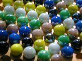 Colourful marbles placed on the game board poster