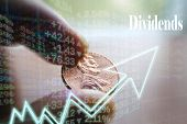 Investment Dividend Concept With Penny In Hand  poster