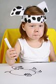 Cute little girl Dalmatian drawing with markers poster
