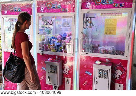 Lukang, Taiwan - December 2, 2018: Person Visits Toy Claw Machine Gaming Shop In Lukang, Taiwan. Cla