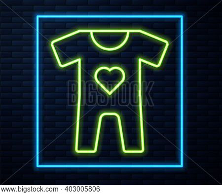 Glowing Neon Line Baby Clothes Icon Isolated On Brick Wall Background. Baby Clothing For Baby Girl A