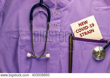 New Covid-19 British Strain Symbol. Medical Uniform, White Card With Words 'new Covid-19 Strain', Me